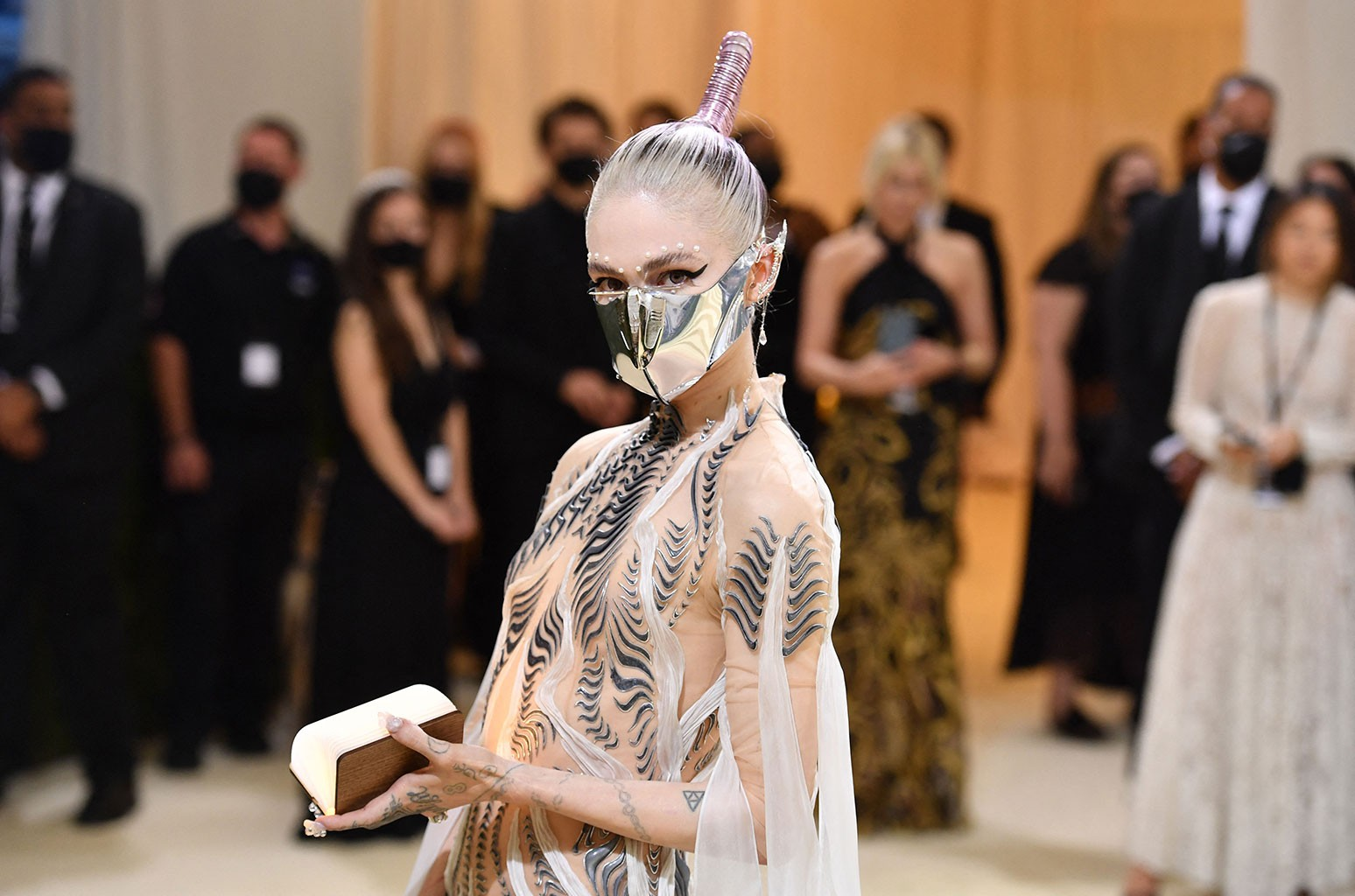 Grimes Fools Paparazzi by Staging Karl Marx Photo